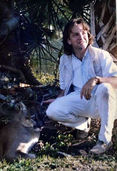 Photo of artist Daniel Ambrose and Florida panther