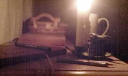 Image of candle burning in artist Daniel Ambrose studio