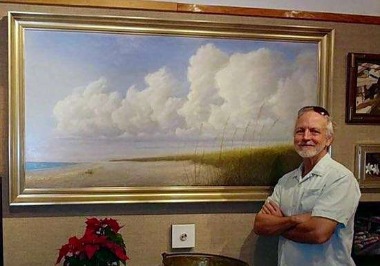 Daniel Ambrose shown with his painting Summer Remembered at Hughes gallery, Boca Grande, Florida